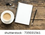 empty notebook and coffee on ... | Shutterstock . vector #735031561