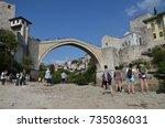 tourists enjoying the view  ... | Shutterstock . vector #735036031