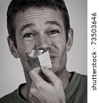 man removing tape from his mouth | Shutterstock . vector #73503646