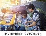 asian tourist photographer... | Shutterstock . vector #735045769