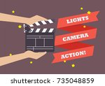hands holding movie clapper... | Shutterstock .eps vector #735048859