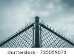 abstract black chain link fence ... | Shutterstock . vector #735059071