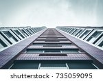 half  modern building adjusted... | Shutterstock . vector #735059095