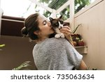 Stock photo woman holding and kissing her cat 735063634