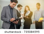 business man working with a... | Shutterstock . vector #735084595
