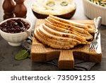 sliced roasted turkey breast... | Shutterstock . vector #735091255