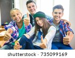 group of teenagers showing... | Shutterstock . vector #735099169