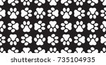 Stock vector dog paw vector cat paw foot print puppy kitten seamless pattern wallpaper background 735104935