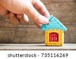 man hold piece of puzzle to... | Shutterstock . vector #735116269