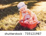 child with a basket of fruit... | Shutterstock . vector #735121987