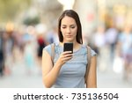 front view of a serious girl... | Shutterstock . vector #735136504