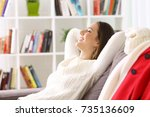 side view of a woman relaxing... | Shutterstock . vector #735136609