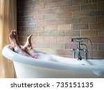 men's  feet covered with foam... | Shutterstock . vector #735151135