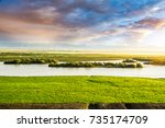 the river is on the prairie | Shutterstock . vector #735174709