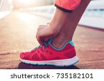 cropped shot view of fit woman... | Shutterstock . vector #735182101