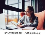 pensive young student in... | Shutterstock . vector #735188119