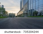 empty road with modern... | Shutterstock . vector #735204244