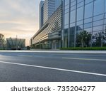 empty road with modern...   Shutterstock . vector #735204277