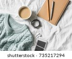 blue knitted sweater  coffee... | Shutterstock . vector #735217294