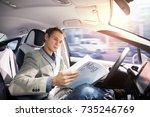 caucasian driver reading... | Shutterstock . vector #735246769
