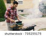 attractive man preparing... | Shutterstock . vector #735255175