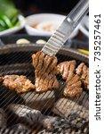pork ribs fortunately served... | Shutterstock . vector #735257461