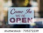 open vintage wooden sign board... | Shutterstock . vector #735272239
