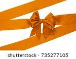 single orange silk bow with... | Shutterstock . vector #735277105