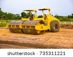 Small photo of Yellow Steamroller parked on the construction site.During a break.
