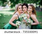 bride and bridesmaids in green... | Shutterstock . vector #735330091