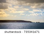 sailing towards the needles on... | Shutterstock . vector #735341671