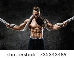 athletic strong man with heavy... | Shutterstock . vector #735343489