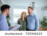 Small photo of Financial adviser explaining the details about the new house to the young couple.