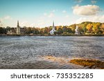 three churches line the... | Shutterstock . vector #735352285