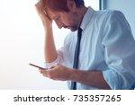 businessman standing next to... | Shutterstock . vector #735357265