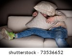 a very scared man watching a... | Shutterstock . vector #73536652