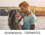 young happy couple enjoys... | Shutterstock . vector #735369121