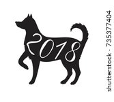 dog silhouette symbol new year... | Shutterstock .eps vector #735377404