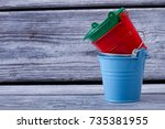 set of colored metal buckets on ... | Shutterstock . vector #735381955
