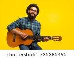 content hipster man in... | Shutterstock . vector #735385495