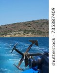 Small photo of Metal anchor of usual boat near the sea