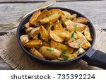 roasted potato with parsley in... | Shutterstock . vector #735392224