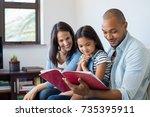 happy multiethnic family...   Shutterstock . vector #735395911