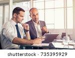 businessman using a digital...   Shutterstock . vector #735395929