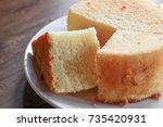 a fluffy orange chiffon cake | Shutterstock . vector #735420931