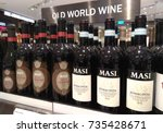 Small photo of CHANGI AIRPORT, SINGAPORE- SEPTEMBER 27, 2017: Variety brand of old world wine on store shelf. Red wine is a type of wine made from dark-colored (black) grape varieties.