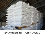 Many Bags On Wooden Pallets...