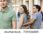 disloyal woman looking another... | Shutterstock . vector #735436885