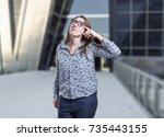 pretty business woman thinking... | Shutterstock . vector #735443155