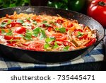 frittata made of eggs  sausage... | Shutterstock . vector #735445471